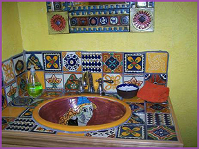 Hand painted Mexican tile adds to the whimsy and fun of the Lost Parrot.