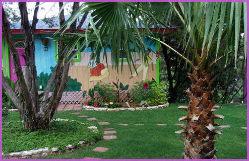Mexican fan palms frame the new Diego Rivera mural hand painted on the Mango Moon Bungalow.